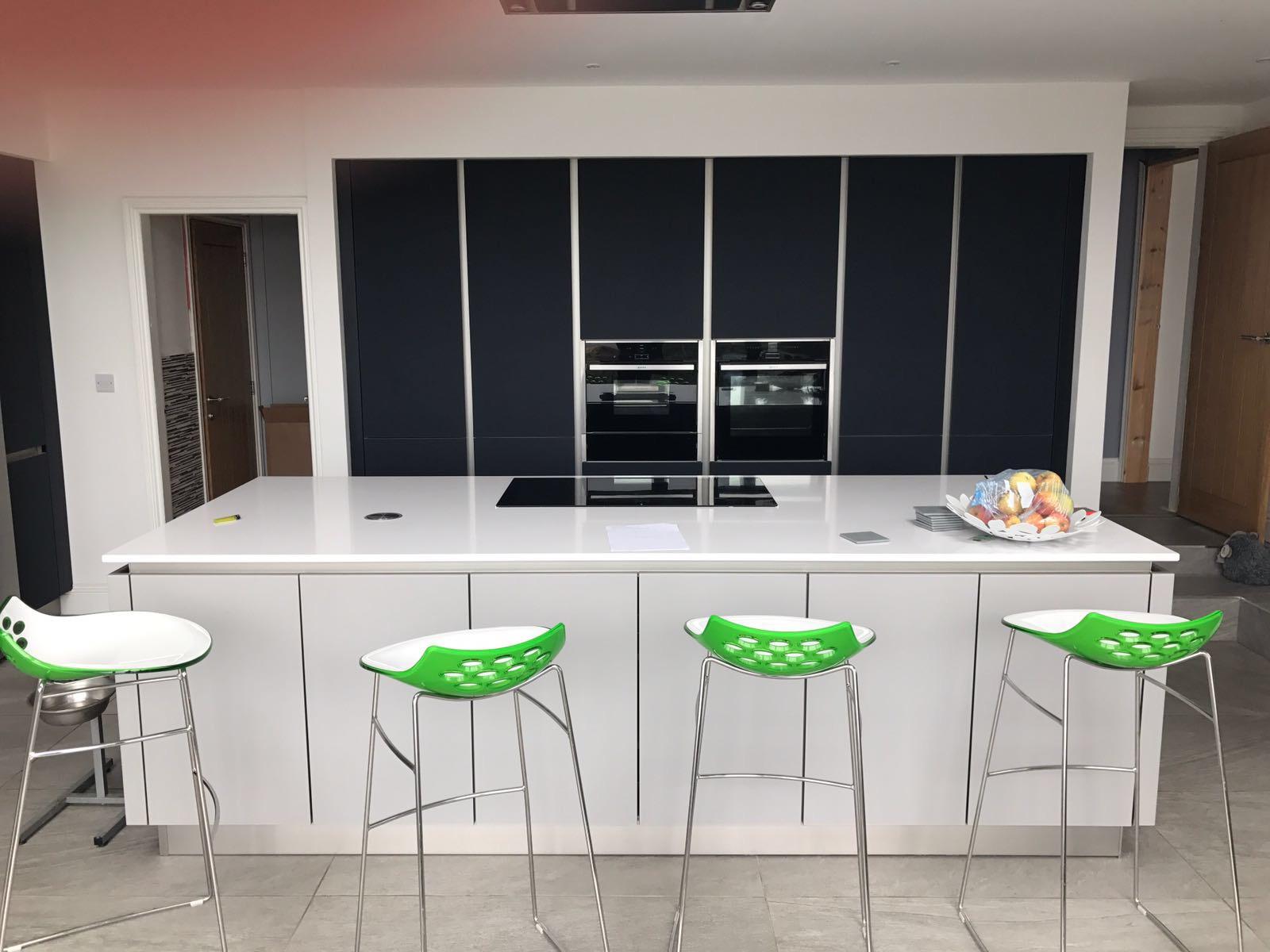 Schuller Next 125 Glassline German kitchen in NX902 Indigo Blue